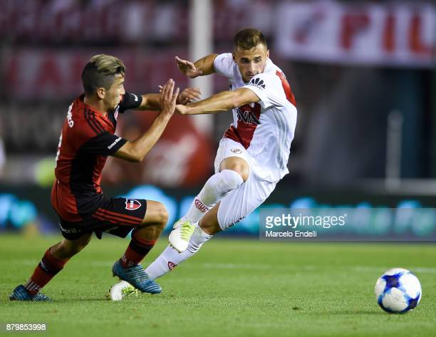 Marcelo Saracchi of River Plate fights for the ball with Joaquin Torres of Newell's Old Boys during a match between River and Newell's Old Boys as...