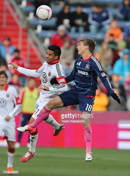 Marcelo Saragosa of DC United and Chris Rolfe of Chicago Fire fight for the ball at Toyota Park on October 27 2012 in Bridgeview Illinois