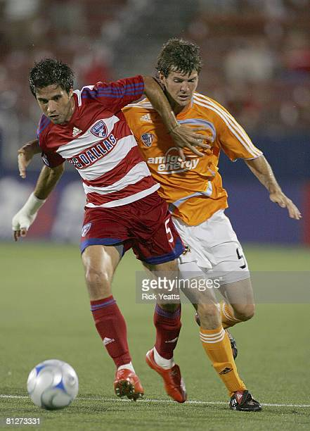 Marcelo Saragosa of FC Dallas moves the ball against Kyle Brown of the Houston Dynamo on May 24, 2008 at Pizza Hut Park in Frisco, Texas. The match...