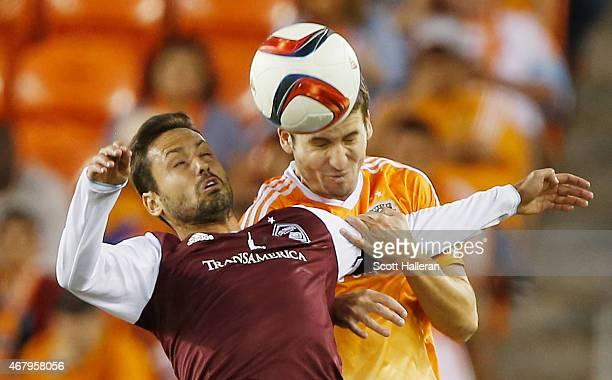 Marcelo Sarvas of the Colorado Rapids battles for the ball with Nathan Sturgis of the Houston Dynamo during their game at BBVA Compass Stadium on...