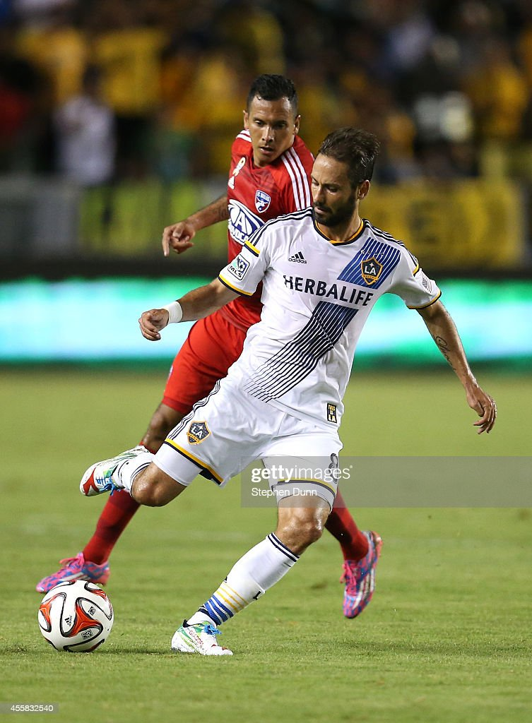 Marcelo Sarvas #8 of the Los Angeles Galaxy controls the ball in front of Blas Perez #7 of FC Dallas at StubHub Center on September 20, 2014 in Los Angeles, California.