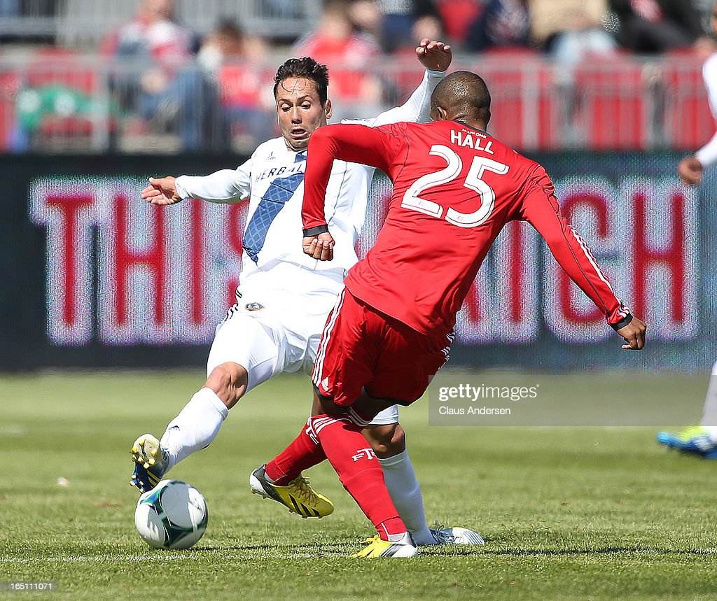 Marcelo Sarvas #8 of the Los Angeles Galaxy defends against Jeremy Hall #25 of Toronto FC in an MLS game on March 30, 2013 at BMO Field in Toronto, Ontario, Canada.