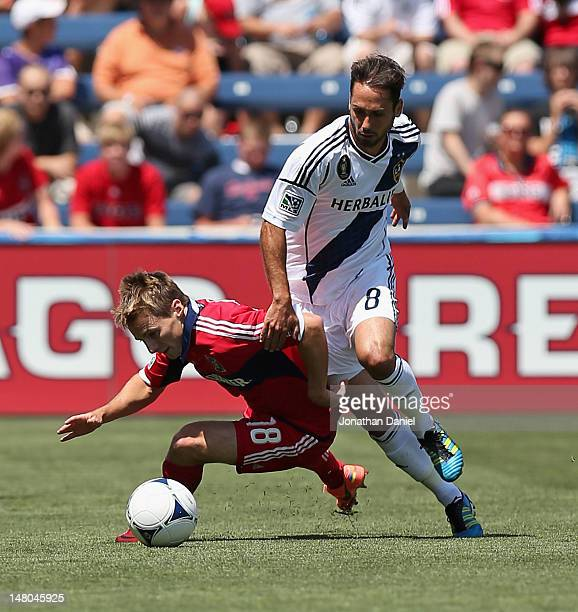 Marcelo Sarvas of the Los Angeles Galaxy knocks down Chris Rolfe of the Chicago Fire during an MLS match at Toyota Park on July 8 2012 in Bridgeview...
