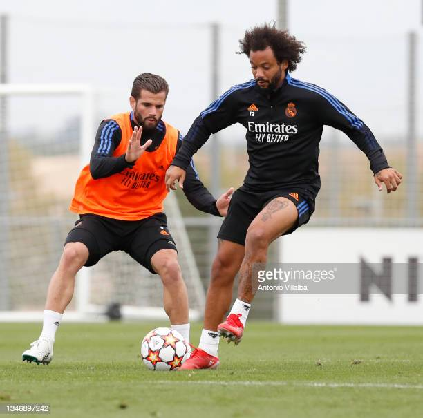 Marcelo Silva and Nacho Fernández of Real Madrid are training at Valdebebas training ground on October 16, 2021 in Madrid, Spain.