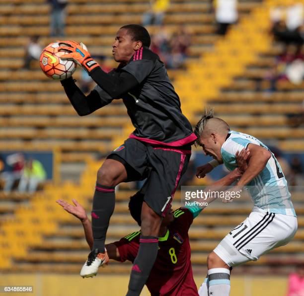 Marcelo Torres right of Argentina fights in the ball before the departure of the goalkeeper of Venezuela Wuilker Fariñez during tournament South...