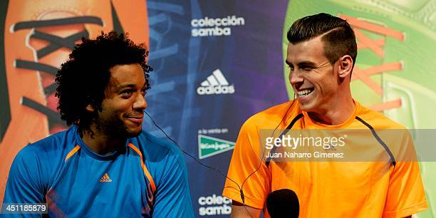 Marcelo Vieira and Gareth Bale attend new Adidas boots presentation at Polideportivo Antonio Magarinos on November 21 2013 in Madrid Spain