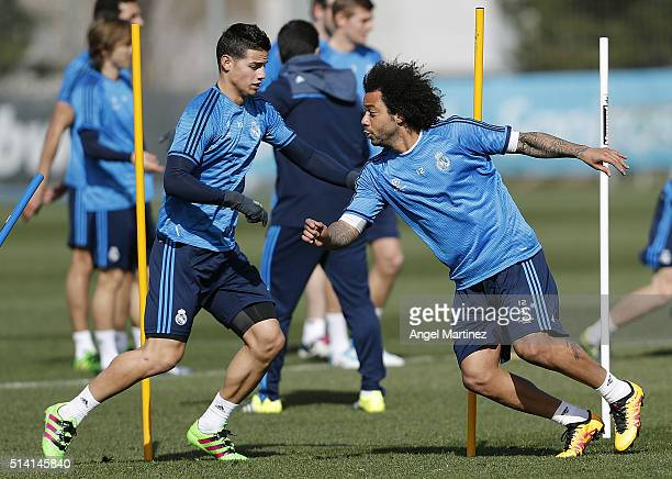 Marcelo Vieira and James Rodriguez of Real Madrid exercise during a training session at Valdebebas training ground on March 7 2016 in Madrid Spain