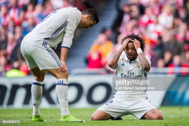 Marcelo Vieira da Silva an Cristiano Ronaldo of Real Madrid reacts during the La Liga match between Athletic Club Bilbao and Real Madrid at San Mames...