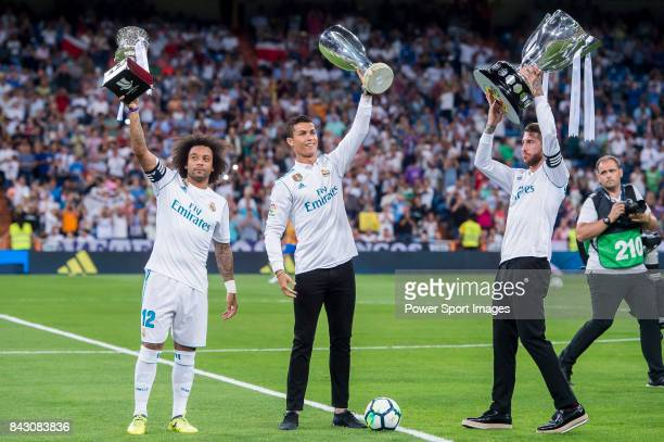 Marcelo Vieira Da Silva Cristiano Ronaldo and Sergio Ramos of Real Madrid hold up their trophies prior to the La Liga 201718 match between Real...