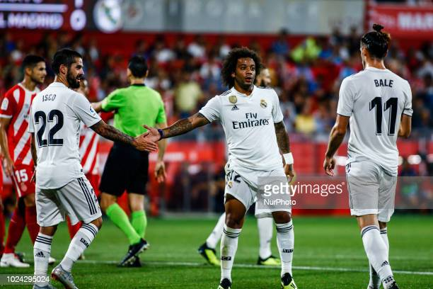12 Marcelo Vieira da Silva from Brazil of Real Madrid talking to 22 Isco Alarcn from Spain of Real Madrid and 11 Gareth Bale from Gales of Real...