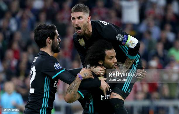 Marcelo Vieira da Silva of Real Madrid celebrates his goal with Sergio Ramos and Isco during the UEFA Champions League Semi Final first leg match...