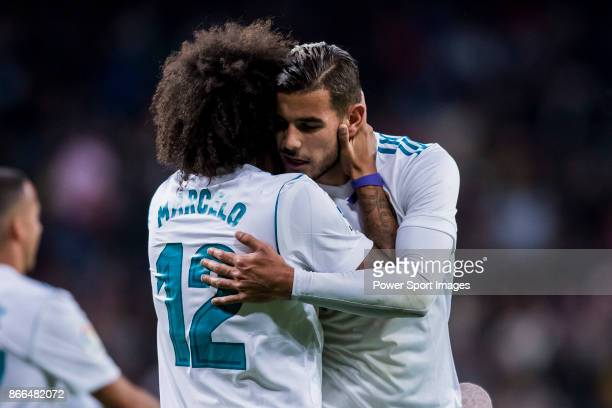 Marcelo Vieira Da Silva of Real Madrid celebrates with Theo Hernandez during the La Liga 201718 match between Real Madrid and SD Eibar at Estadio...
