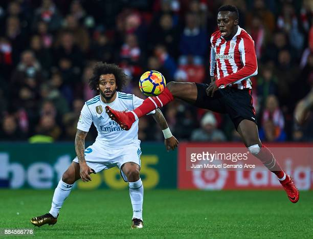 Marcelo Vieira da Silva of Real Madrid CF competes for the ball with Inaki Williams of Athletic Club during the La Liga match between Athletic Club...