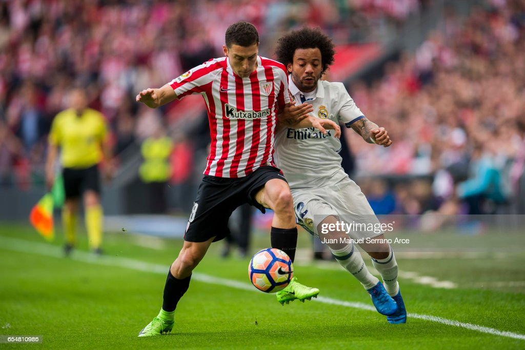 Marcelo Vieira da Silva of Real Madrid competes for the ball with Oscar De Marcos of Athletic Club during the La Liga match between Athletic Club Bilbao and Real Madrid at San Mames Stadium on on March 18, 2017 in Bilbao, Spain.