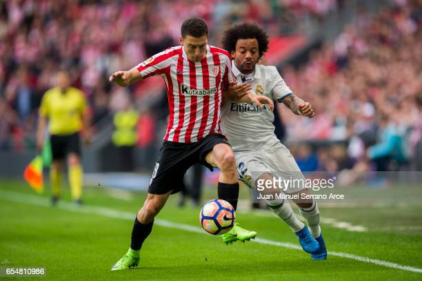 Marcelo Vieira da Silva of Real Madrid competes for the ball with Oscar De Marcos of Athletic Club during the La Liga match between Athletic Club...
