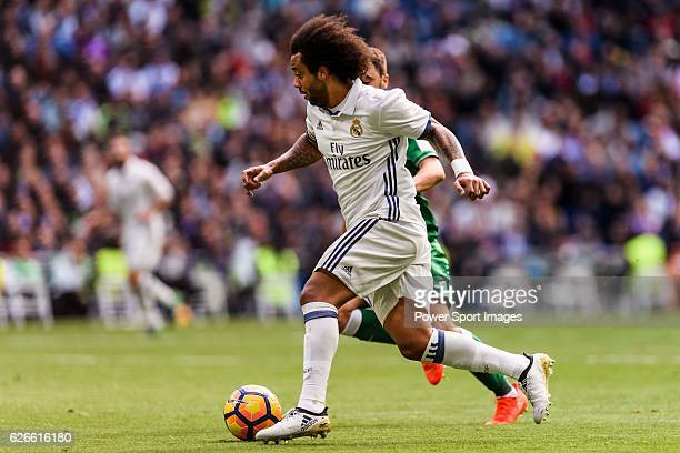 Marcelo Vieira Da Silva of Real Madrid competes for the ball with Unai Lopez of Deportivo Leganes during their La Liga match between Real Madrid and...
