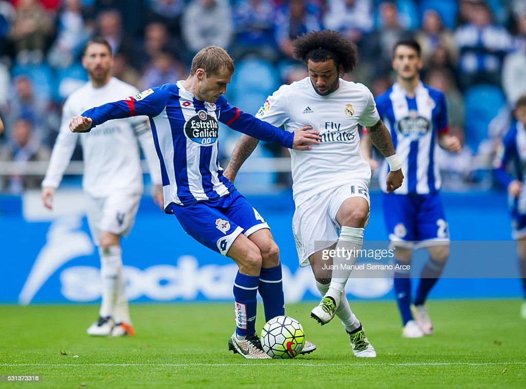 Marcelo Vieira da Silva of Real Madrid duels for the ball with Alex Bergantinos of RC Deportivo La Coruna during the La Liga match between RC Deportivo La Coruna and Real Madrid CF at Riazor Stadium on May 14, 2016 in La Coruna, Spain.