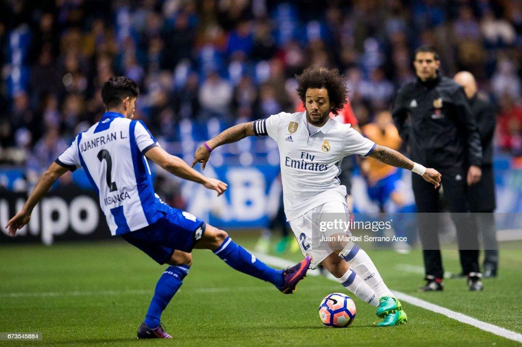 Marcelo Vieira da Silva of Real Madrid duels for the ball with Juan Francisco Moreno of RC Deportivo La Coruna during the La Liga match between RC Deportivo La Coruna and Real Madrid at Riazor Stadium on April 26, 2017 in La Coruna, Spain.