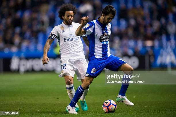Marcelo Vieira da Silva of Real Madrid duels for the ball with Alejandro Arribas of RC Deportivo La Coruna during the La Liga match between RC...
