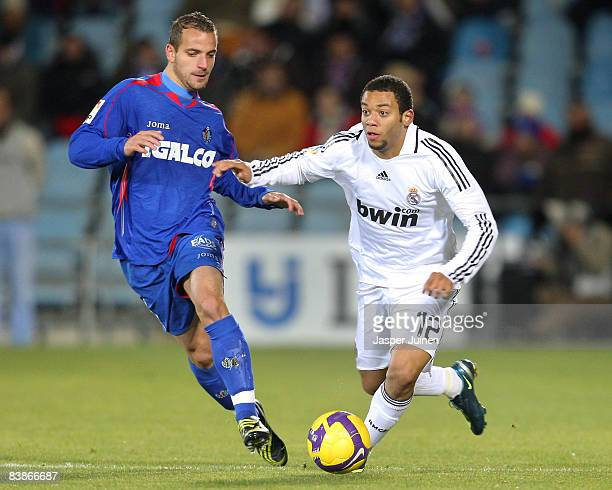 Marcelo Vieira Da Silva of Real Madrid duels for the ball with Roberto Soldado of Getafe during the La Liga match between Getafe and Real Madrid at...