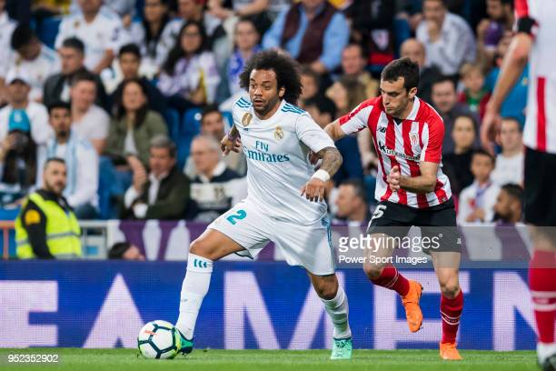 Marcelo Vieira Da Silva of Real Madrid fights for the ball with Inigo Lekue of Athletic Club de Bilbao during the La Liga match between Real Madrid...