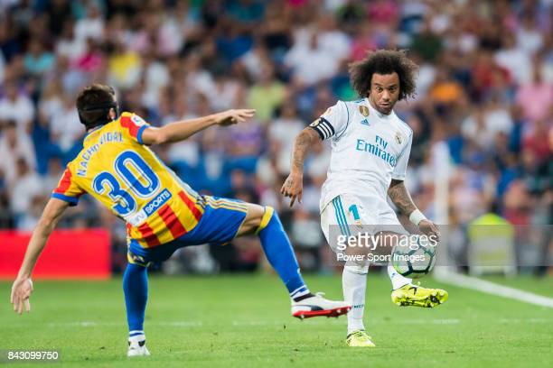 Marcelo Vieira Da Silva of Real Madrid fights for the ball with Nacho Vidal of Valencia CF during their La Liga 201718 match between Real Madrid and...