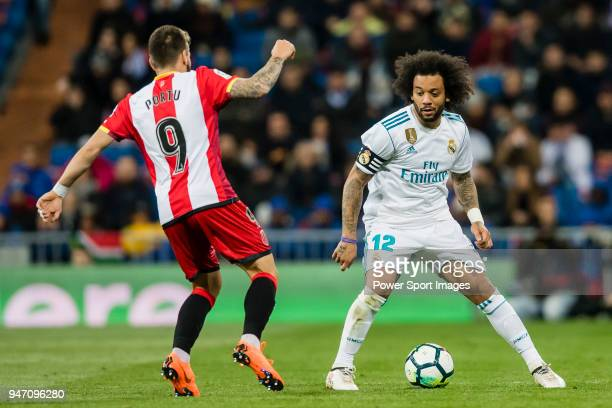 Marcelo Vieira Da Silva of Real Madrid fights for the ball with Cristian Portugues Manzanera Portu of Girona FC during the La Liga 201718 match...