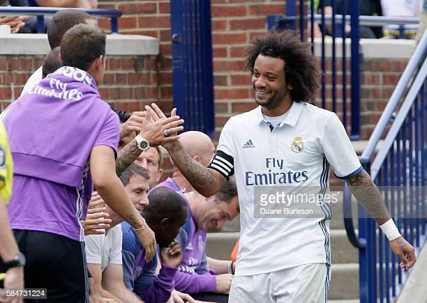 Marcelo Vieira Da Silva of Real Madrid is congratulated after scoring a goal against Chelsea during the first half at Michigan Stadium on July 30...