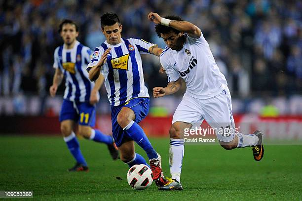 Marcelo Vieira of Real Madrid battles for the ball with Javi Marquez of RCD Espanyol during La Liga match between RCD Espanyol and Real Madrid at...
