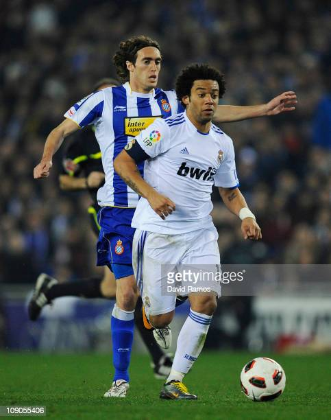 Marcelo Vieira of Real Madrid battles for the ball with Joan Verdu of RCD Espanyol during La Liga match between RCD Espanyol and Real Madrid at...