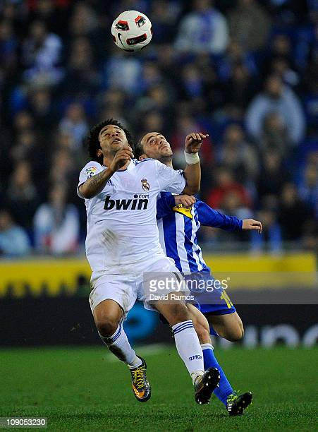 Marcelo Vieira of Real Madrid battles for the ball with Sergio Garcia of RCD Espanyol during La Liga match between RCD Espanyol and Real Madrid at...
