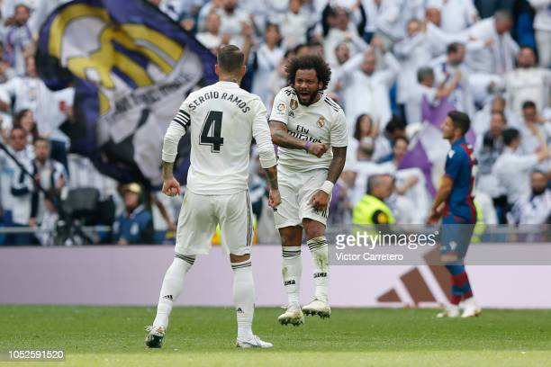Marcelo Vieira of Real Madrid celebrates with teammate Sergio Ramos after scoring his team's first goal during the La Liga match between Real Madrid...