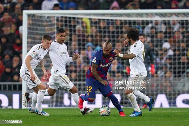 Marcelo Vieira of Real Madrid CF battle for the ball with Arturo Vidal of FC Barcelona during the Liga match between Real Madrid CF and FC Barcelona...