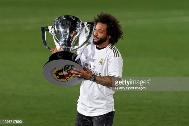 Marcelo Vieira of Real Madrid CF poses with the La Liga trophy after Real Madrid secure the La Liga title during the La Liga match between Real...