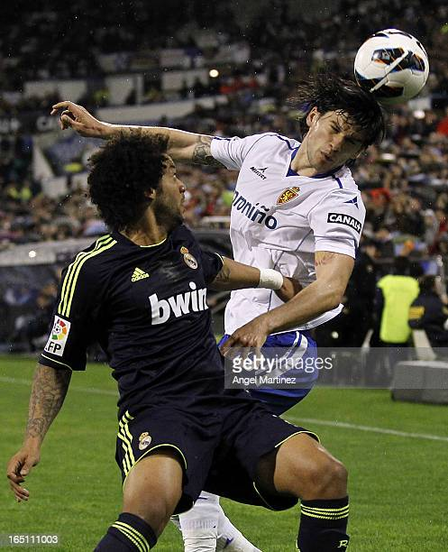 Marcelo Vieira of Real Madrid competes for the ball with Cristian Sapunaru of Real Zaragoza during the La Liga match between Real Zaragoza and Real...