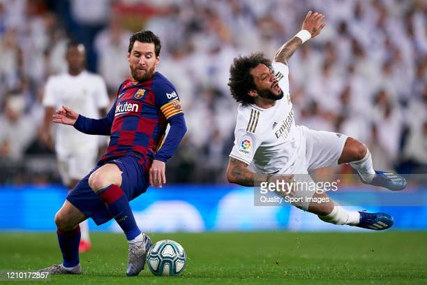 Marcelo Vieira of Real Madrid competes for the ball with Lionel Messi of FC Barcelona during the La Liga match between Real Madrid CF and FC...