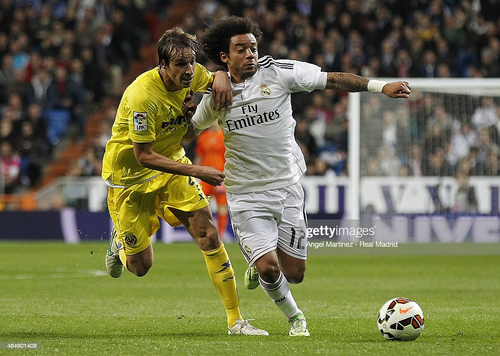 Marcelo Vieira of Real Madrid competes for the ball with Tomas Pina of Villarreal during the La Liga match between Real Madrid CF and Villarreal CF at Estadio Santiago Bernabeu on March 1, 2015 in Madrid, Spain.