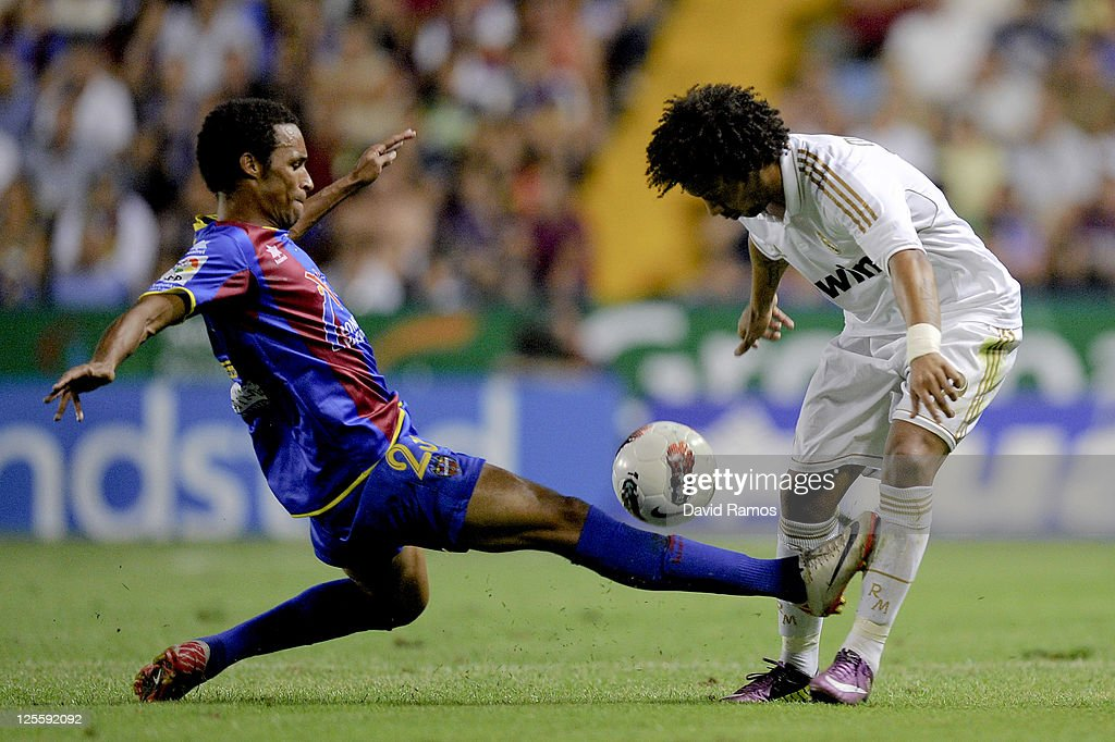 Marcelo Vieira of Real Madrid duels for the ball with Valmiro Lopes of Levante UD during the La Liga match between Levante UD and Real Madrid CF at Ciutat de Valencia Stadium on September 18, 2011 in Valencia, Spain. Levante UD won 1-0.