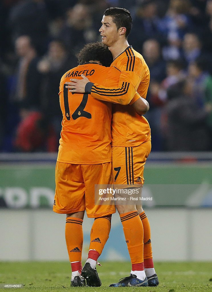 Marcelo Vieira (L) of Real Madrid embraces Cristiano Ronaldo at the end of the La Liga match between RCD Espanyol and Real Madrid at Cornella-El Prat Stadium on January 12, 2014 in Barcelona, Spain.