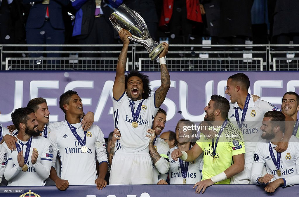 Marcelo Vieira of Real Madrid lifts the trophy after the UEFA Super Cup match between Real Madrid and Sevilla at Lerkendal Stadion on August 9, 2016 in Trondheim, Norway.