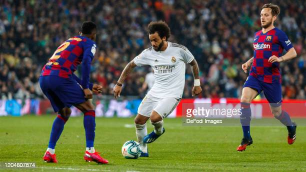 Marcelo Vieira of Real Madrid Nelson Semedo and Ivan Rakitic of FC Barcelona controls the ball during the Liga match between Real Madrid CF and FC...