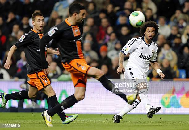 Marcelo Vieira of Real Madrid passes the ball past Adil Rami of Valencia during the Copa del Rey Quarter Final match between Real Madrid and Valencia...