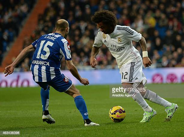 Marcelo Vieira of Real Madrid vies with Laure of Deportivo during the La Liga match between Real Madrid CF and RC Deportivo La Coruna at Estadio...