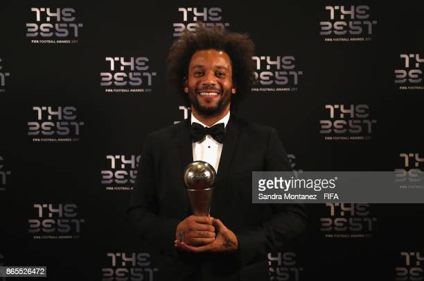 Marcelo Vieira poses with his FIFA FIFPro World 11 award after being included in the team of the year during The Best FIFA Football Awards at The...