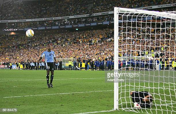 Marcelo Zalayeta of Uruguay forces Mark Schwarzer of Australia to produce a fine save in the penalty shootout during the second leg of the 2006 FIFA...