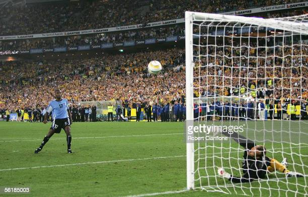 Marcelo Zalayeta of Uruguay forces Mark Schwarzer of Australia to produce a fine save in the penalty shoutout during the second leg of the 2006 FIFA...