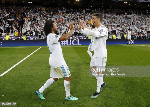 Marceloa and Cristiano Ronaldo of Real Madrid celebrate after the UEFA Champions League Semi Final Second Leg match between Real Madrid and Bayern...