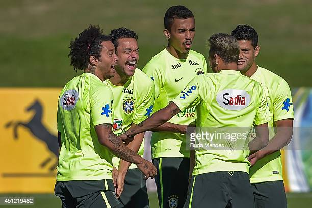 MarceloFredLuis GustavoNeymar and Hulk joke during a training session of the Brazilian national football team at the squad's Granja Comary training...