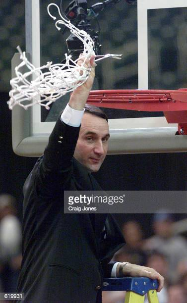 Head Coach Mike Krzyzewski of the Duke Blue Devils celebrates their 79-53 victory over the North Carolina Tar Heels with net in hand after the ACC...