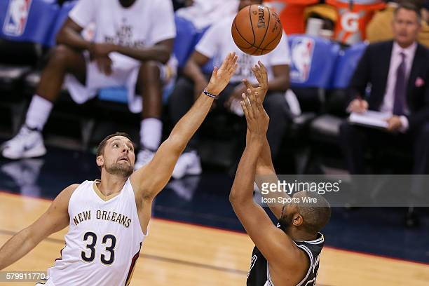 New Orleans Pelicans guard Norris Cole shoots against New Orleans Pelicans forward Ryan Anderson during the NBA game between the San Antonio Spurs...